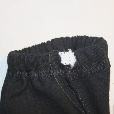 Black thread holding elastic in place
