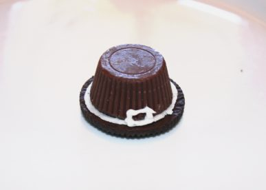 Add trim to the peanut butter cup so it looks like a little pilgrim's hat