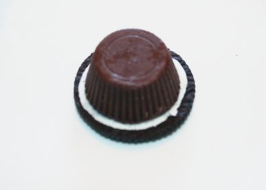 A peanut butter cup on top of the Oreo