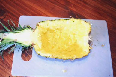 A hallowed out half of pineapple