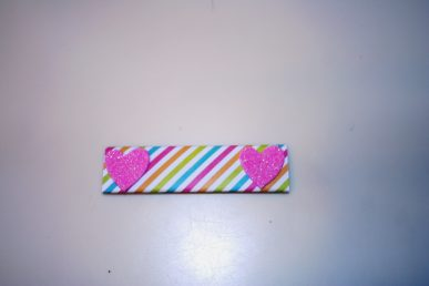 A stick of gum wrapped in colored paper