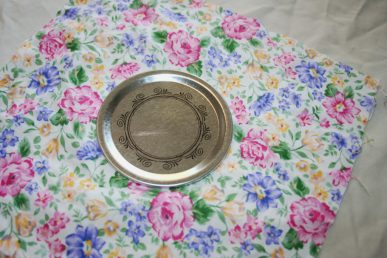 A lid of a jar on a flowery piece of fabric