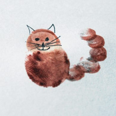 A cat made from finger prints