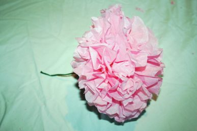 A pink flower made from tissue paper