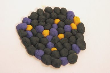 Little clay balls arranged in a circle.