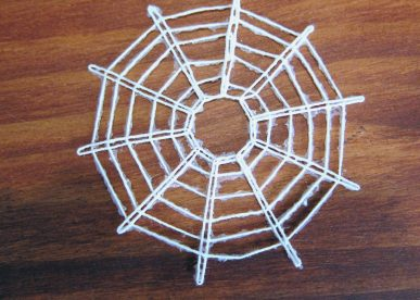 The finished spider web ornament for Christmas.