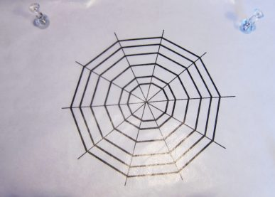 A spider web pattern covered with wax paper