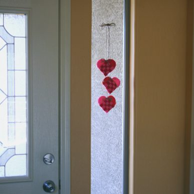 Hearts dangling in a window