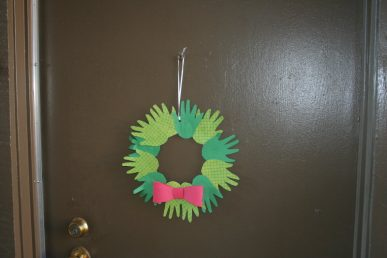 A wreath hanging on a door.