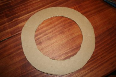 The cardboard ring at the base of the wreath