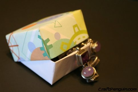 A box with a bracelet draped in it