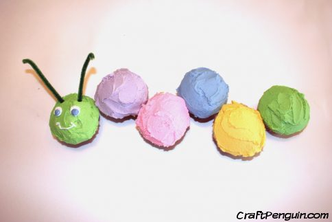 A wiggly caterpillar made from colored cupcakes