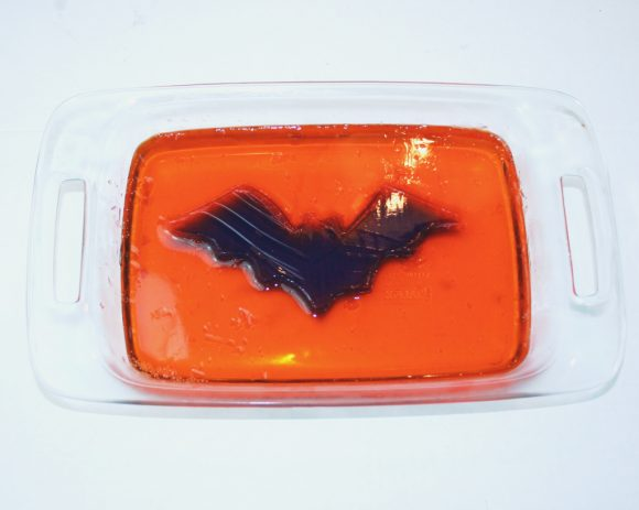 Orange jello around the purple bat.